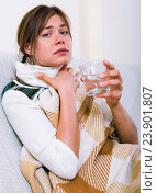 Купить «Young woman having heavy sickly tonsillitis», фото № 23901807, снято 23 марта 2019 г. (c) Яков Филимонов / Фотобанк Лори