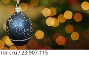 Купить «Christmas blue ball shakes at bokeh. Title area», видеоролик № 23907115, снято 18 ноября 2015 г. (c) Александр Багно / Фотобанк Лори