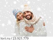 Купить «smiling couple in winter clothes hugging over snow», фото № 23921779, снято 3 октября 2015 г. (c) Syda Productions / Фотобанк Лори