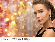 Купить «beautiful woman with gem stone earrings», фото № 23921895, снято 17 марта 2013 г. (c) Syda Productions / Фотобанк Лори