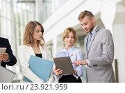 Купить «business team with tablet pc and folders at office», фото № 23921959, снято 3 июля 2016 г. (c) Syda Productions / Фотобанк Лори