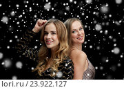 Купить «happy young women dancing at night club disco», фото № 23922127, снято 21 ноября 2015 г. (c) Syda Productions / Фотобанк Лори