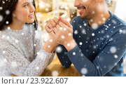 Купить «happy couple holding hands at restaurant or cafe», фото № 23922607, снято 23 января 2016 г. (c) Syda Productions / Фотобанк Лори