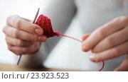 Купить «woman with crochet hook unweaving knitting», видеоролик № 23923523, снято 22 октября 2016 г. (c) Syda Productions / Фотобанк Лори