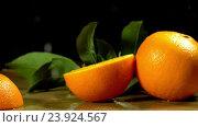 Купить «Group of oranges with leaves on wooden boards.», видеоролик № 23924567, снято 22 октября 2016 г. (c) Gennadiy Poznyakov / Фотобанк Лори