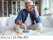 Купить «Tensed senior man checking the bills», фото № 23946451, снято 1 июля 2016 г. (c) Wavebreak Media / Фотобанк Лори