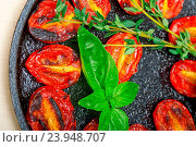 Купить «Oven baked cherry tomatoes with basil and thyme on a cast iron skillet», фото № 23948707, снято 4 ноября 2014 г. (c) easy Fotostock / Фотобанк Лори
