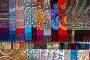 Знаменитые платки в ассортименте с различными рисунками Павловопосадской платочной мануфактуры в фирменном магазине в Павловском Посаде, Россия, фото № 23958023, снято 26 октября 2016 г. (c) Николай Винокуров / Фотобанк Лори