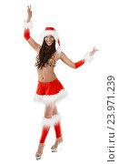 Купить «Милая сексуальная девушка в новогоднем костюме, изолировано на белом фоне», фото № 23971239, снято 1 декабря 2012 г. (c) Евгений Захаров / Фотобанк Лори
