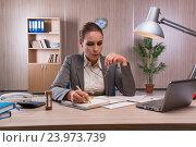 Купить «Businesswoman working in the office», фото № 23973739, снято 26 июля 2016 г. (c) Elnur / Фотобанк Лори