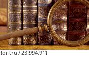 Купить «Ancient old books and magnifying glass», видеоролик № 23994911, снято 26 октября 2016 г. (c) Андрей Армягов / Фотобанк Лори