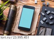 Макет смартфона на столе с в окружении различных предметов. Стоковое фото, фотограф ouh_desire / Фотобанк Лори