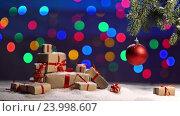 Купить «Christmas ball and a fir branch with gift box on a wooden background with snowing and lighten bokeh hotspot», видеоролик № 23998607, снято 30 октября 2016 г. (c) Анатолий Типляшин / Фотобанк Лори