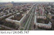 Купить «Panoramic aerial view of one of the districts of Moscow, road traffic, cloudy weather. Urban cityscape from quadrocopter», видеоролик № 24045747, снято 22 сентября 2016 г. (c) Данил Руденко / Фотобанк Лори