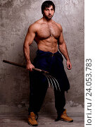 Купить «Guy with perfect body holding pitchfork», фото № 24053783, снято 7 октября 2014 г. (c) easy Fotostock / Фотобанк Лори