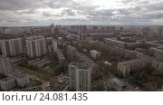 Купить «Panoramic aerial view of one of the districts of Moscow, cloudy weather. Urban cityscape from quadrocopter», видеоролик № 24081435, снято 22 сентября 2016 г. (c) Данил Руденко / Фотобанк Лори