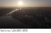 Купить «Aerial view of the old part of Prague and bridges over the Vltava river at sunrise. Urban landscape», видеоролик № 24081959, снято 22 сентября 2016 г. (c) Данил Руденко / Фотобанк Лори