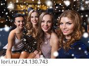 Купить «happy smiling women taking selfie at night club», фото № 24130743, снято 21 ноября 2015 г. (c) Syda Productions / Фотобанк Лори