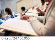 Купить «student writing to notebook at exam or lecture», фото № 24130955, снято 19 июня 2016 г. (c) Syda Productions / Фотобанк Лори