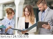 Купить «business team with tablet pc and folders at office», фото № 24130975, снято 3 июля 2016 г. (c) Syda Productions / Фотобанк Лори
