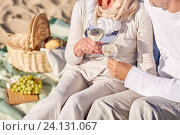 Купить «happy senior couple having picnic on summer beach», фото № 24131067, снято 18 августа 2015 г. (c) Syda Productions / Фотобанк Лори
