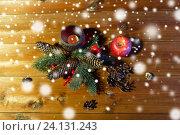 Купить «christmas fir branch decoration and candle lantern», фото № 24131243, снято 1 октября 2015 г. (c) Syda Productions / Фотобанк Лори