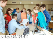 group of students and teacher at school classroom. Стоковое фото, фотограф Syda Productions / Фотобанк Лори