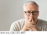 Купить «close up of senior man in glasses thinking», фото № 24131487, снято 7 июля 2016 г. (c) Syda Productions / Фотобанк Лори