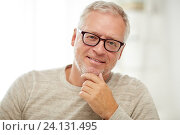 Купить «close up of smiling senior man in glasses thinking», фото № 24131495, снято 7 июля 2016 г. (c) Syda Productions / Фотобанк Лори