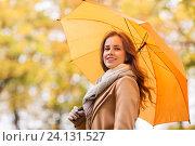 Купить «happy woman with umbrella walking in autumn park», фото № 24131527, снято 6 октября 2016 г. (c) Syda Productions / Фотобанк Лори