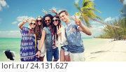 Купить «hippie friends with smartphone on selfie stick», фото № 24131627, снято 27 августа 2015 г. (c) Syda Productions / Фотобанк Лори