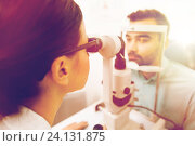 Купить «optician with slit lamp and patient at eye clinic», фото № 24131875, снято 25 ноября 2015 г. (c) Syda Productions / Фотобанк Лори
