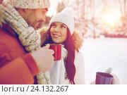 Купить «happy couple with tea cups over winter landscape», фото № 24132267, снято 23 января 2016 г. (c) Syda Productions / Фотобанк Лори