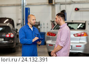 Купить «auto mechanic with clipboard and man at car shop», фото № 24132391, снято 1 июля 2016 г. (c) Syda Productions / Фотобанк Лори
