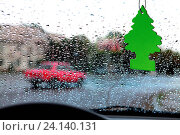 Купить «Dashboard and rain droplets, car's ventilation system with an air freshener on it», фото № 24140131, снято 26 июля 2013 г. (c) easy Fotostock / Фотобанк Лори