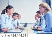 Купить «smiling business people having conflict in office», фото № 24144311, снято 25 октября 2014 г. (c) Syda Productions / Фотобанк Лори