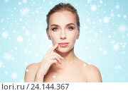Купить «beautiful young woman showing her lips over snow», фото № 24144367, снято 14 апреля 2016 г. (c) Syda Productions / Фотобанк Лори