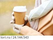 Купить «close up of woman with coffee in autumn park», фото № 24144543, снято 6 октября 2016 г. (c) Syda Productions / Фотобанк Лори