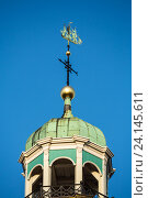 Leer, Germany, weather banner on the church spire of the Great Church in Leer (2014 год). Редакционное фото, агентство Caro Photoagency / Фотобанк Лори