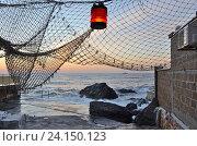 Купить «Морской пейзаж на закате с рыболовной сетью и фонарём. Крым, Форос», фото № 24150123, снято 13 сентября 2016 г. (c) Ирина Носова / Фотобанк Лори