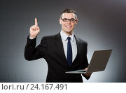 Young businessman with laptop in business concept. Стоковое фото, фотограф Elnur / Фотобанк Лори