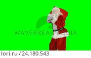Купить «Santa claus with finger on lips carrying sack», видеоролик № 24180543, снято 11 июля 2020 г. (c) Wavebreak Media / Фотобанк Лори