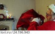 Купить «Santa claus carrying sack with present», видеоролик № 24196943, снято 11 июля 2020 г. (c) Wavebreak Media / Фотобанк Лори