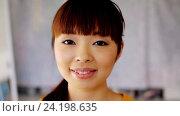 Купить «face of happy smiling asian young woman», видеоролик № 24198635, снято 6 ноября 2016 г. (c) Syda Productions / Фотобанк Лори