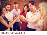 Купить «Composite image of group of friends toasting shots», фото № 24202115, снято 16 июня 2019 г. (c) Wavebreak Media / Фотобанк Лори