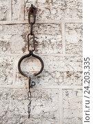Купить «Medieval shackles mounted in old wall», фото № 24203335, снято 1 мая 2016 г. (c) EugeneSergeev / Фотобанк Лори