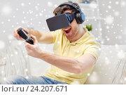 Купить «man in virtual reality headset with controller», фото № 24207671, снято 12 марта 2016 г. (c) Syda Productions / Фотобанк Лори