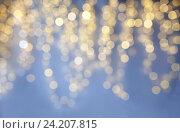 Купить «blurred christmas holidays lights bokeh», фото № 24207815, снято 15 октября 2016 г. (c) Syda Productions / Фотобанк Лори
