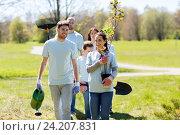 Купить «group of volunteers with trees and rake in park», фото № 24207831, снято 7 мая 2016 г. (c) Syda Productions / Фотобанк Лори