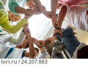 Купить «group of international students holding hands», фото № 24207883, снято 19 июня 2016 г. (c) Syda Productions / Фотобанк Лори